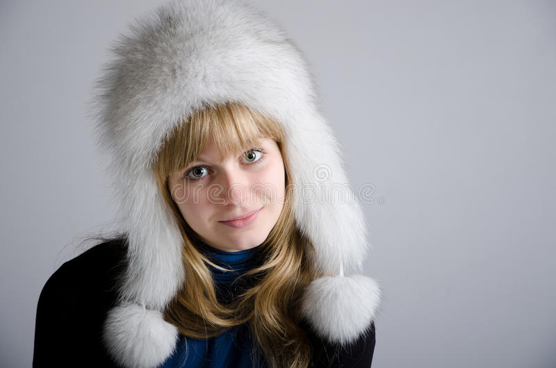 Download Girl in a fur hat stock image. Image of white, background - 21572077