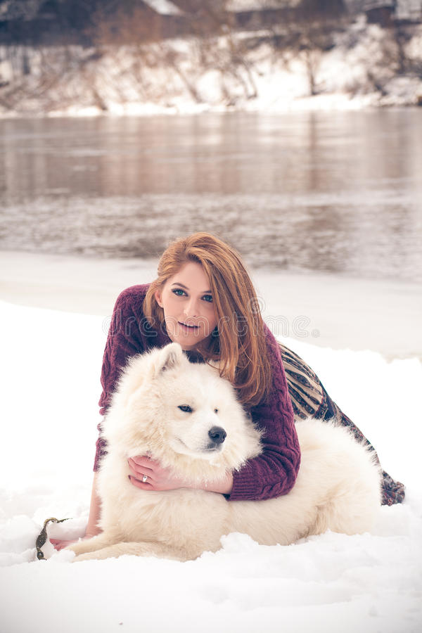 Download Girl with samoed dog stock image. Image of obedience - 29702333