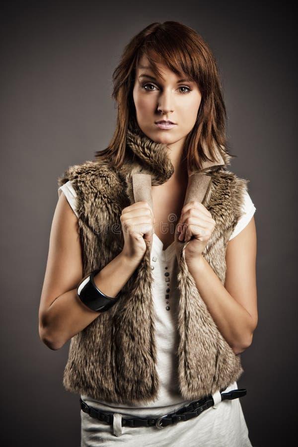Girl In Fur Vest Stock Photo