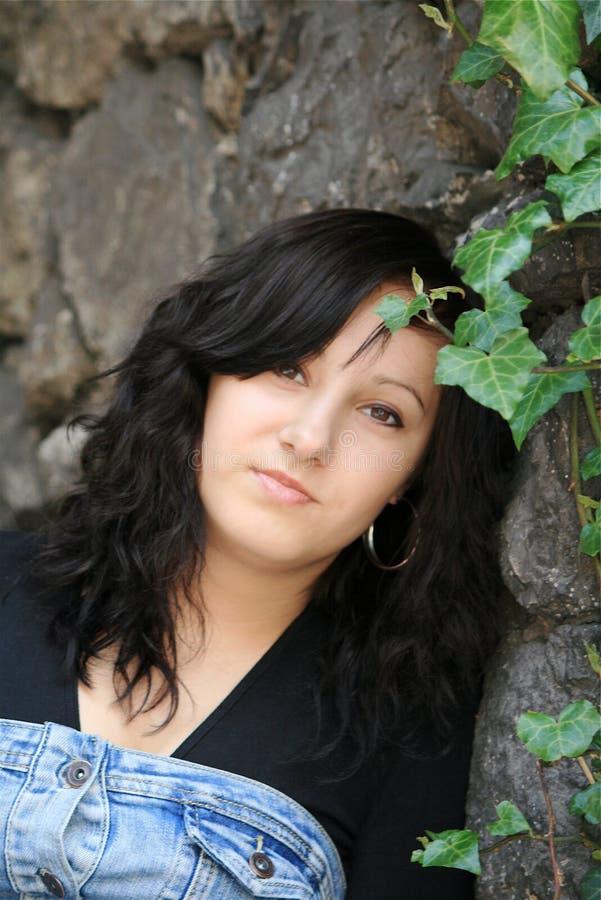 A girl in the garden. Krakow, Poland royalty free stock image