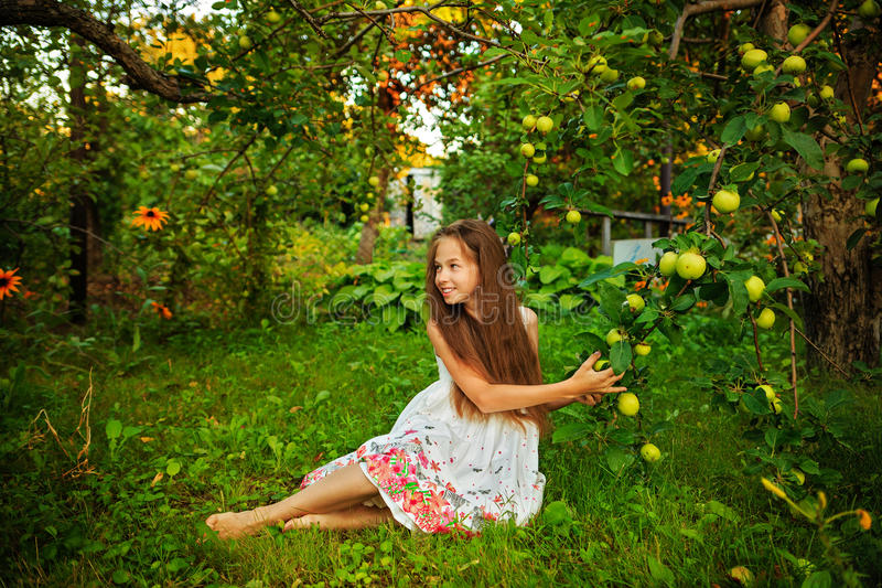 Girl in garden stock photo. Image of background, baby