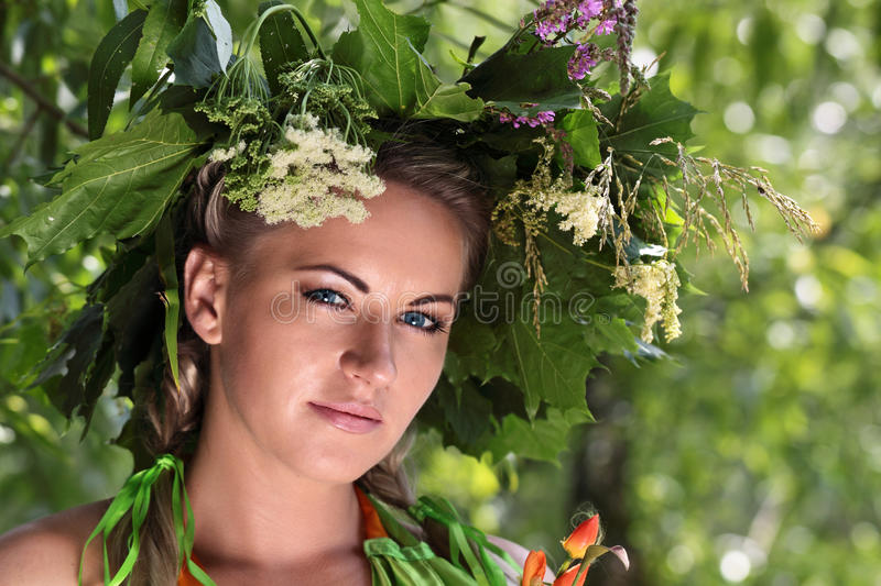 The Girl With The Garland Royalty Free Stock Photography