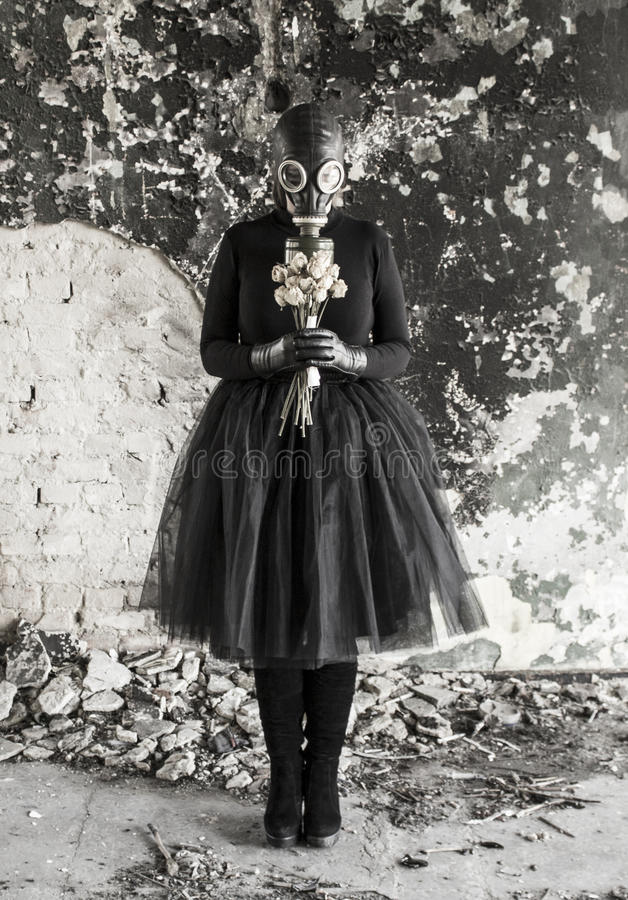 The girl in a gas mask. The threat of ecology. stock photos