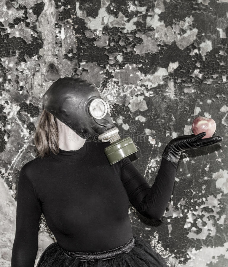 The girl in a gas mask. The threat of ecology. royalty free stock image