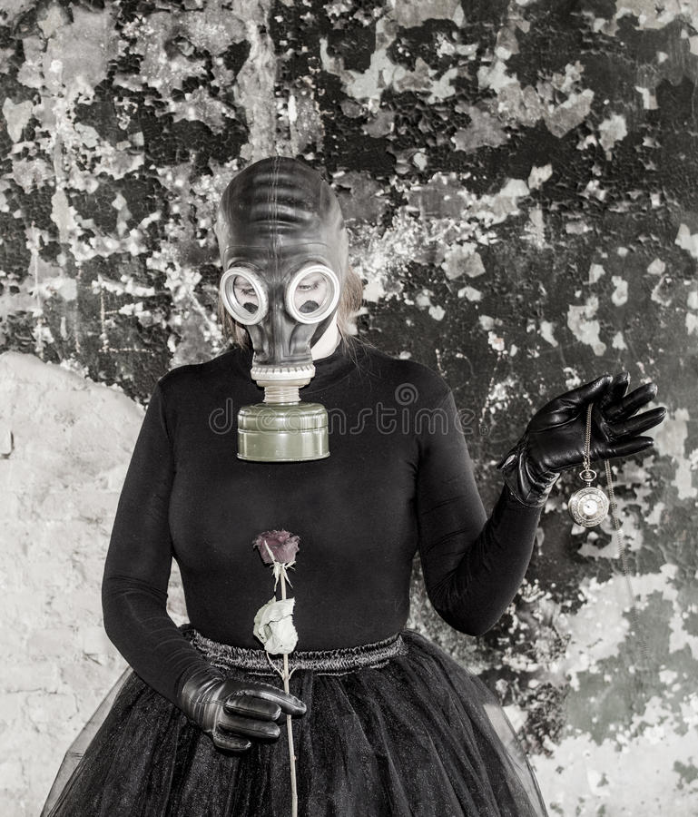 The girl in a gas mask. The threat of ecology. The idea of âEUR royalty free stock images