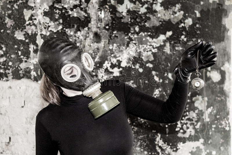 The girl in a gas mask. The threat of ecology. stock images