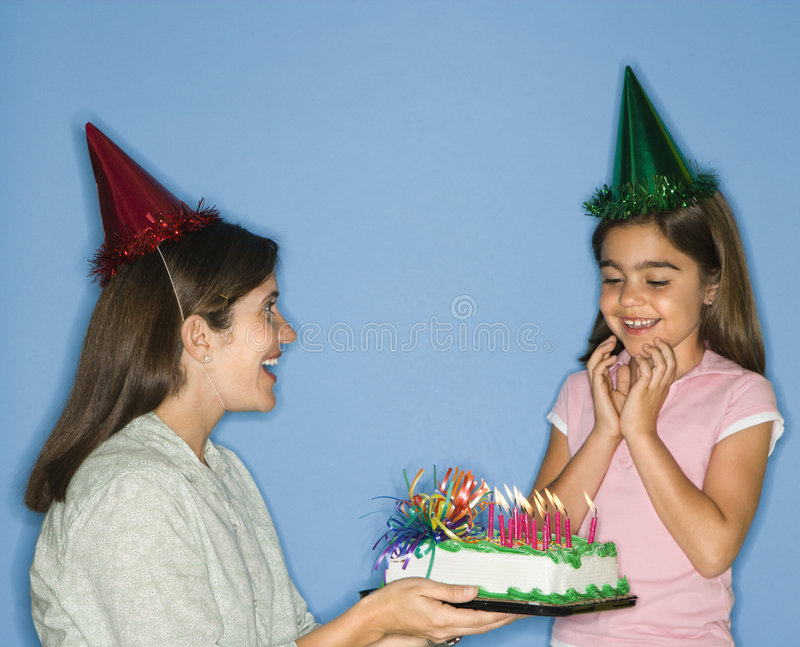 Girl getting birthday cake. royalty free stock photo