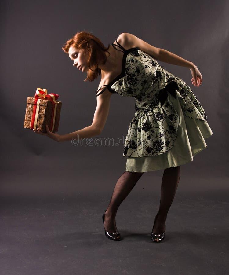 Girl with a gift stock photos