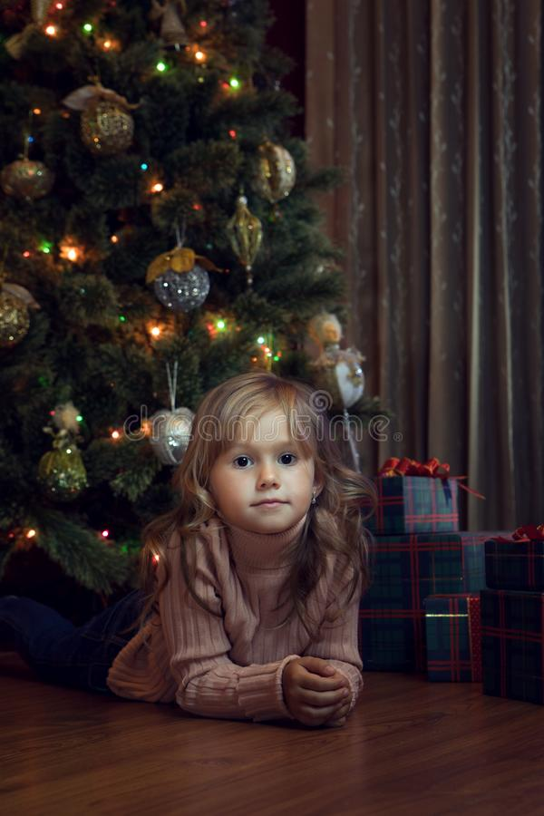 Girl with gift box in  christmas domestic environment royalty free stock photos