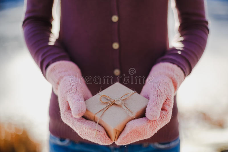 Girl with a gift in her hands. Adolescent winter outdoor stock photography