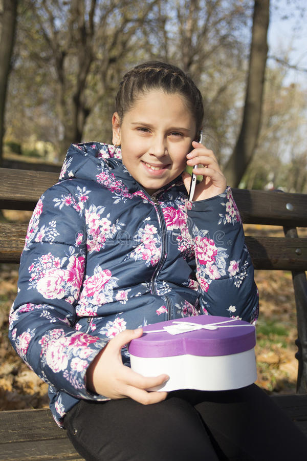 Download The Girl With A Gift In The Park Stock Photo - Image: 83708356
