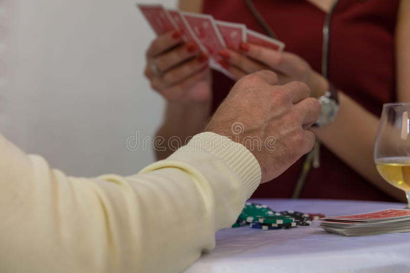 Girl gives a deck of cards. To the man stock images