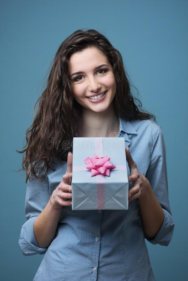 Girl giving a beautiful gift royalty free stock photos