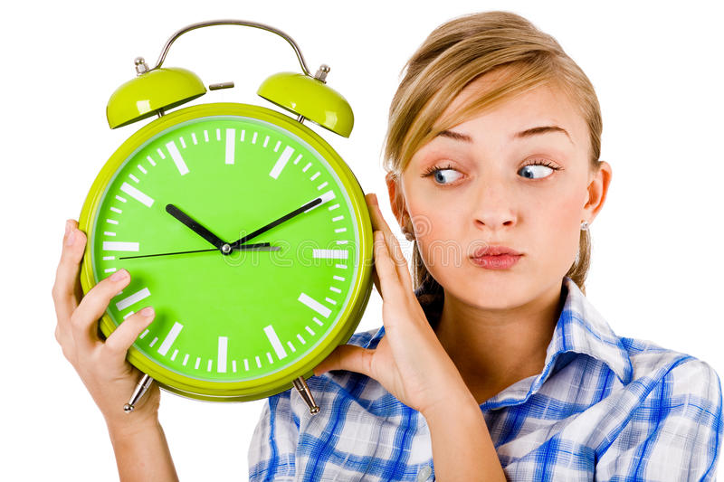 Download Girl Giving Funny Expression And Holding The Alarm Stock Image - Image: 12269077