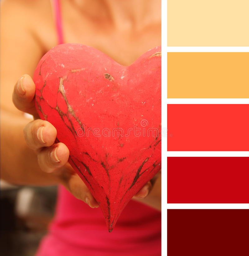 Girl giving hands heart. color palette swatches.. pastel hues. Girl giving hands heart. color palette swatches royalty free stock photo