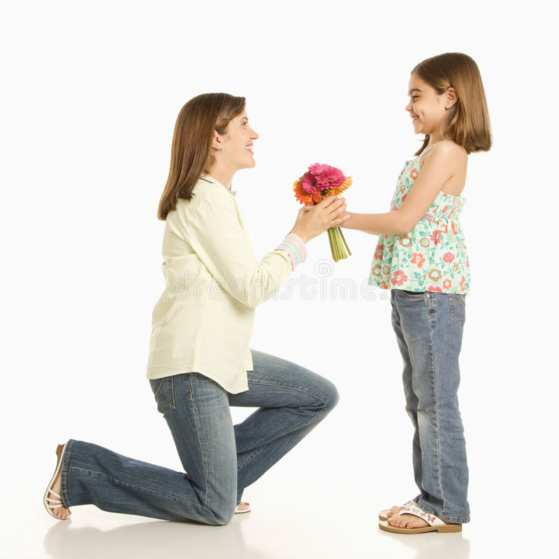 Girl giving mother flowers. stock photos