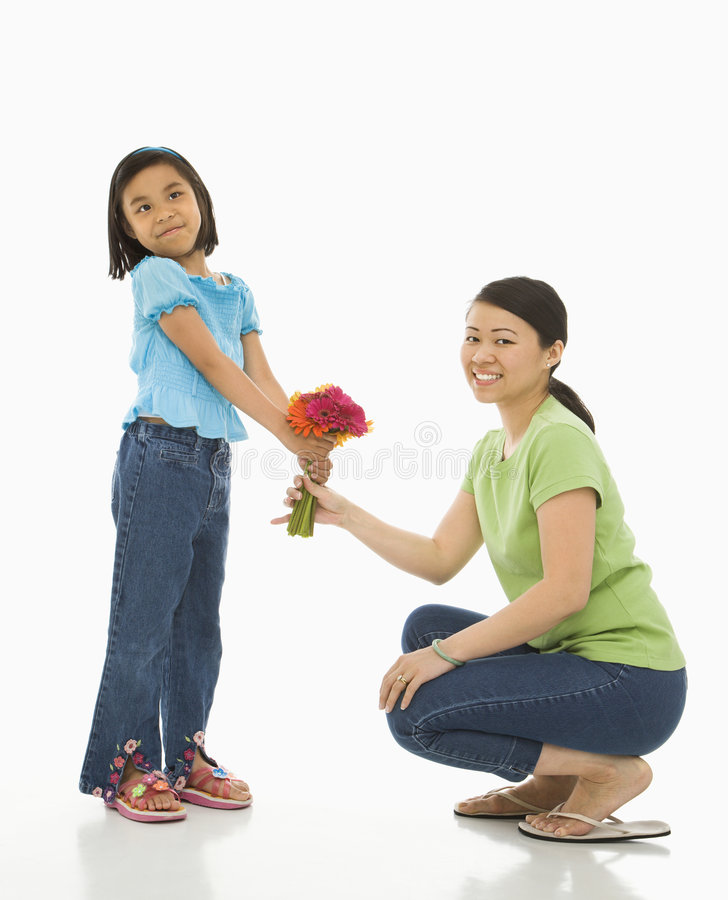 Girl giving mother flowers. royalty free stock photos