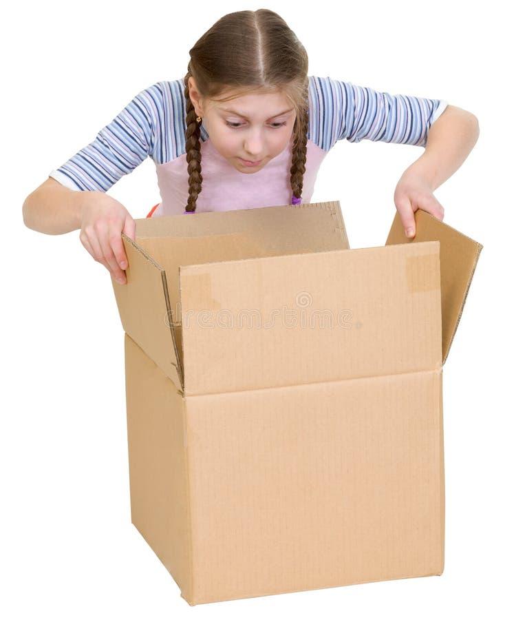 Girl Glance At Cardboard Box Royalty Free Stock Photos