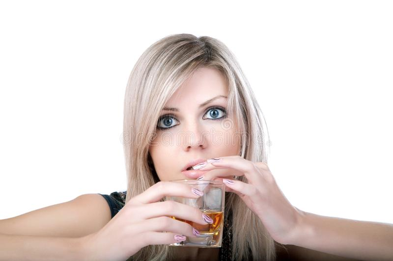 Girl with a glass of brandy close up. On white royalty free stock photography