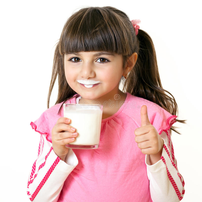 Girl with a glass of milk royalty free stock photos
