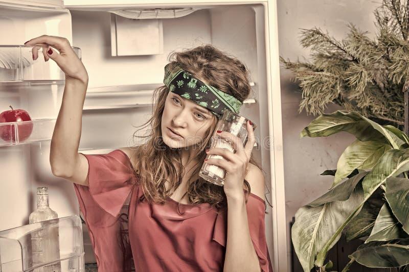 Girl with glass of milk posing at fridge stock image