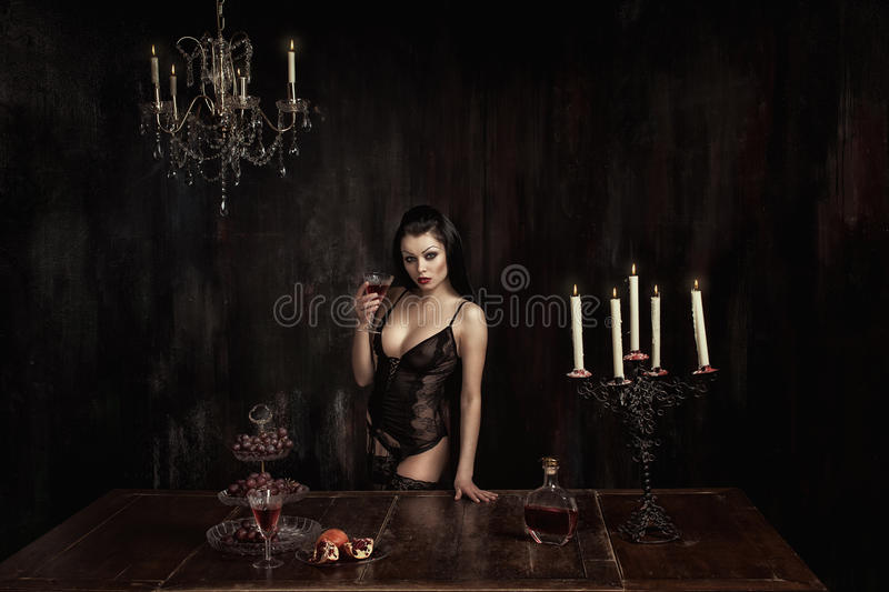 Girl with glass of wine royalty free stock photography