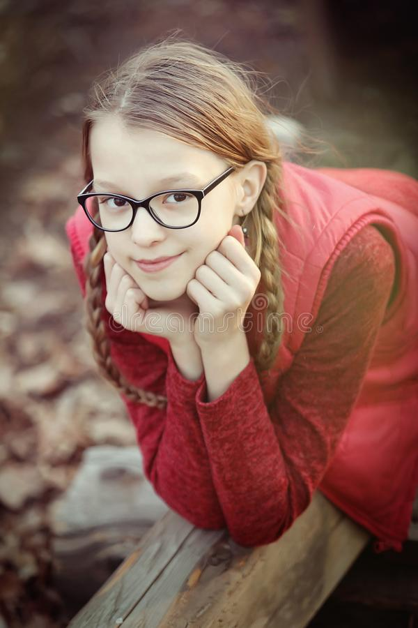 Girl in glasses is looking royalty free stock photos