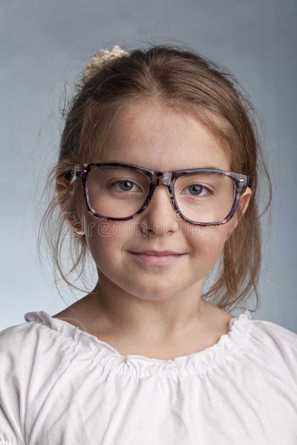 Girl with glasses and special look royalty free stock photos
