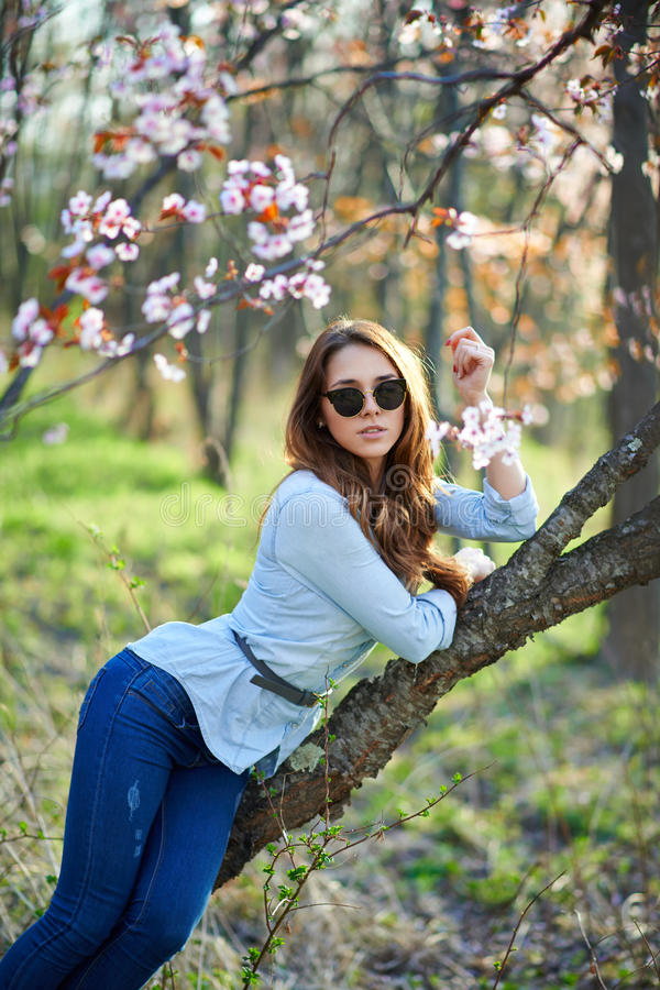 Girl with glasses in the trees royalty free stock photo