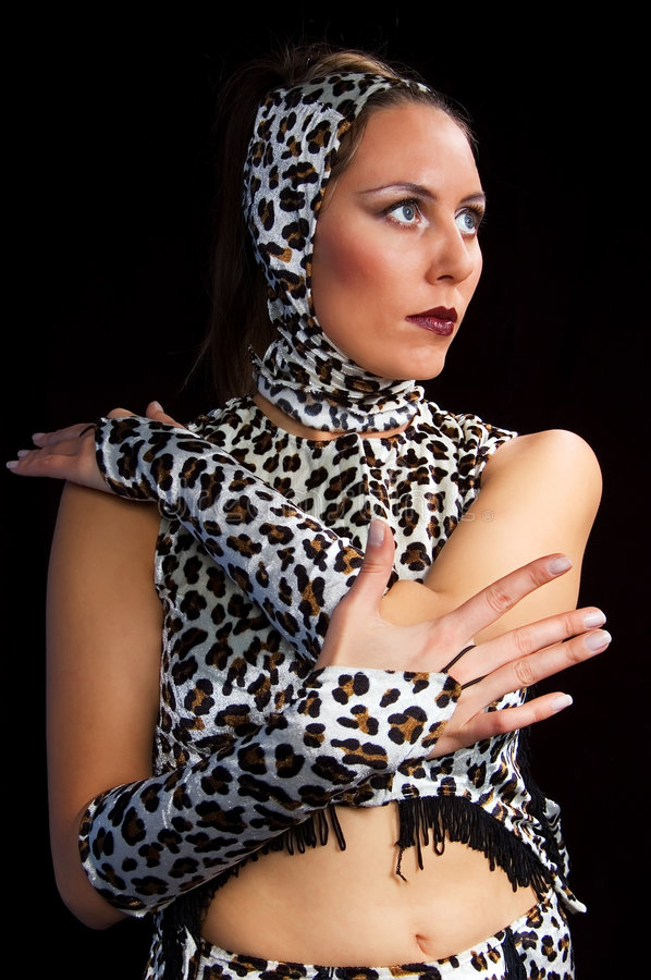 A girl in gloves 2. A white girl in gloves on a black background royalty free stock photo