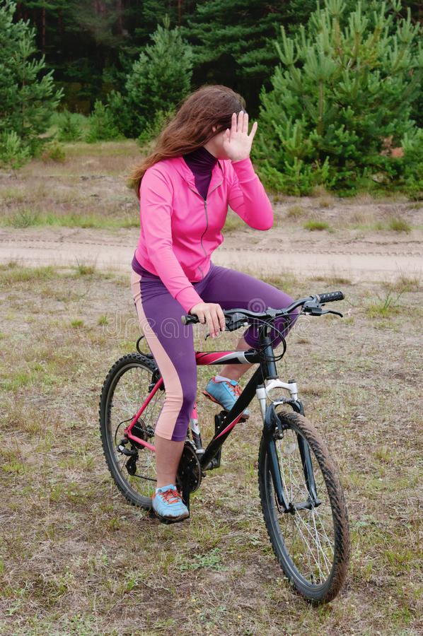 Download The girl goes on a bicycle stock photo. Image of competition - 17947026