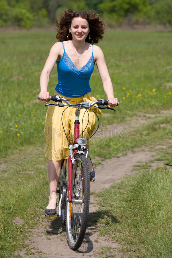 Download Girl goes by bicycle stock photo. Image of curly, cycling - 9419862