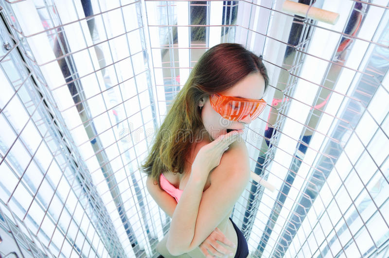 Girl goes light therapy session stock photo