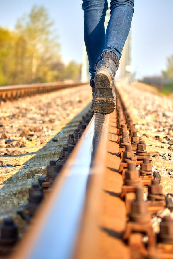 the girl goes by rail along the rails royalty free stock photo