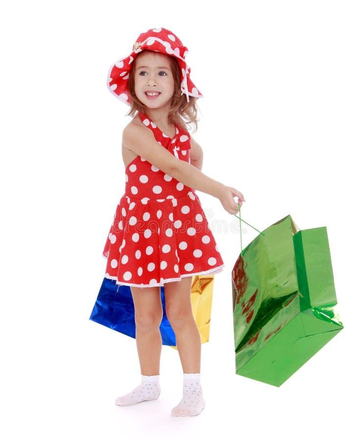 Girl goes shopping stock photos