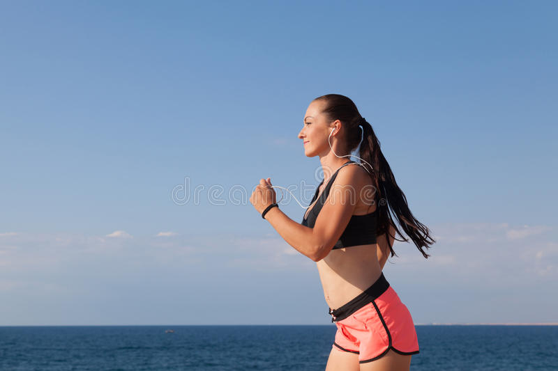 Girl goes in for sports training on the beach stock photography