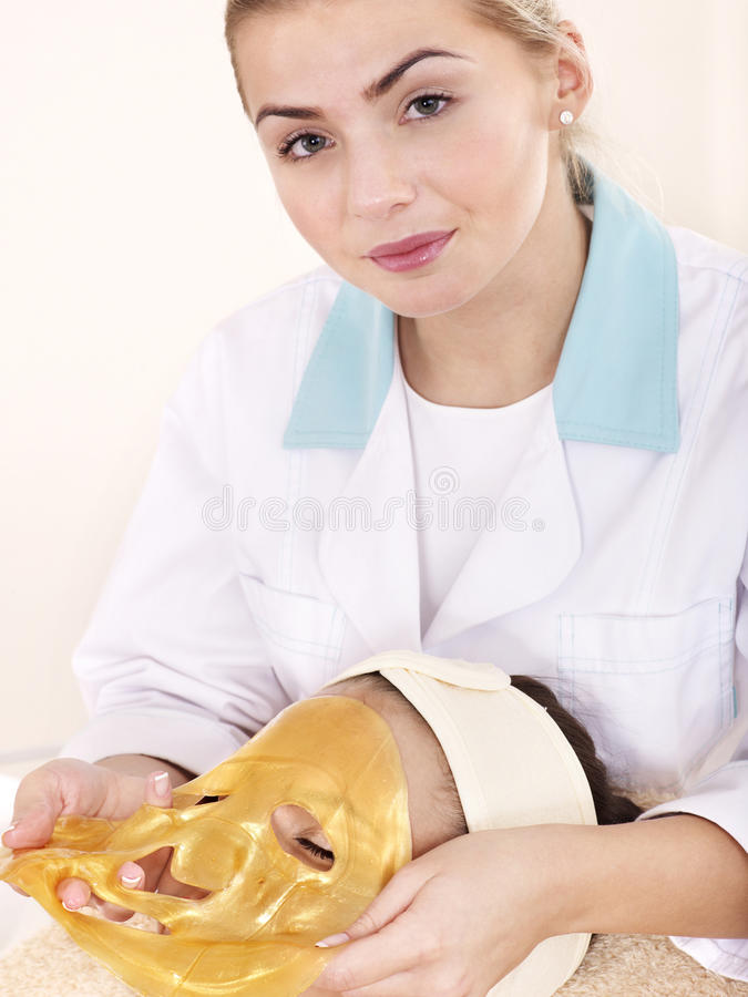 Download Girl With Gold Facial Mask. Royalty Free Stock Photography - Image: 18004067