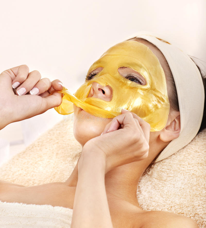 Girl with gold facial mask. stock image