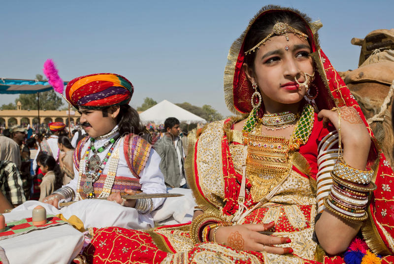 Girl with gold jewelry and traditional dress of India stock images