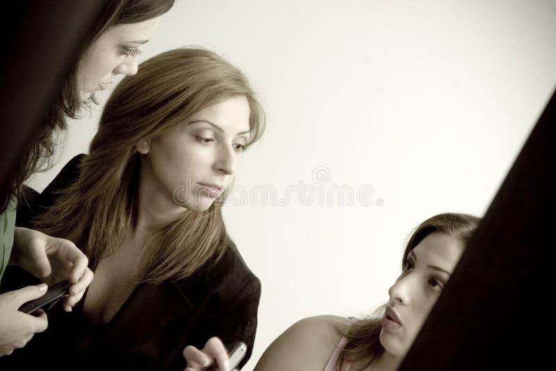 Girl gossiping stock photos