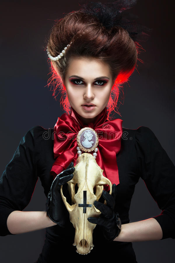 Girl in gothic art style. Girl in gothic art style with creative makeup and skull royalty free stock photos