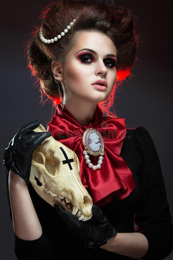 Girl in gothic art style. Girl in gothic art style with creative makeup and skull royalty free stock images