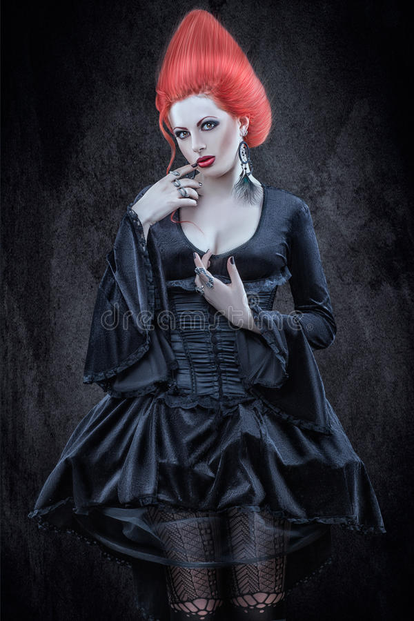 Girl in Gothic style. Girl with red hair in the Gothic style royalty free stock images