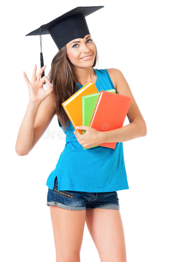 Girl with graduation hat. Beautiful girl with graduation hat holding book, isolated on white background stock images