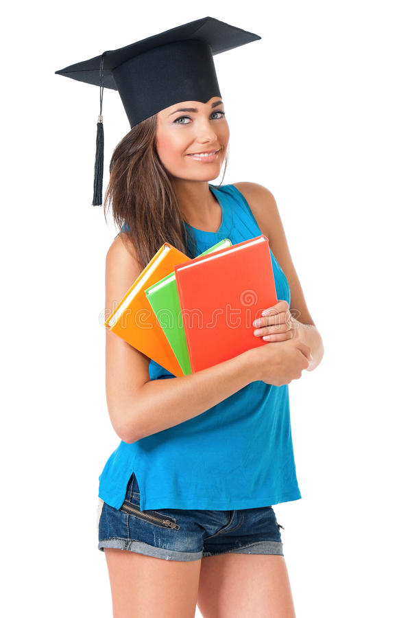 Girl with graduation hat. Beautiful girl with graduation hat holding book, on white background royalty free stock photo