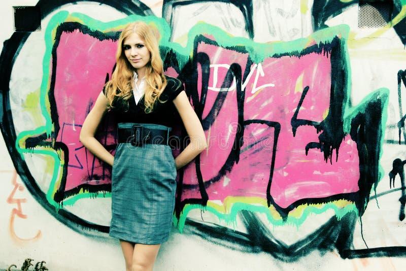 Girl and graffiti royalty free stock photography