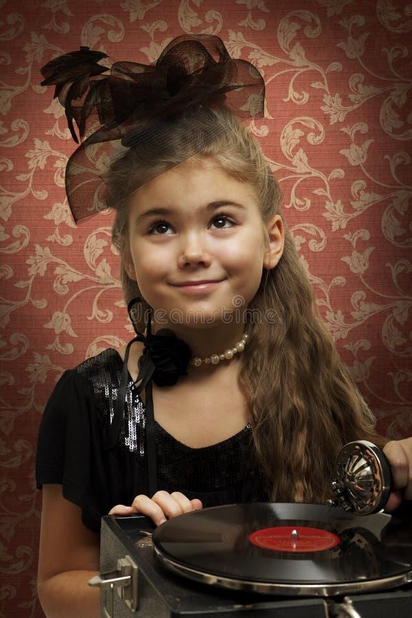 Girl with gramophone stock photo