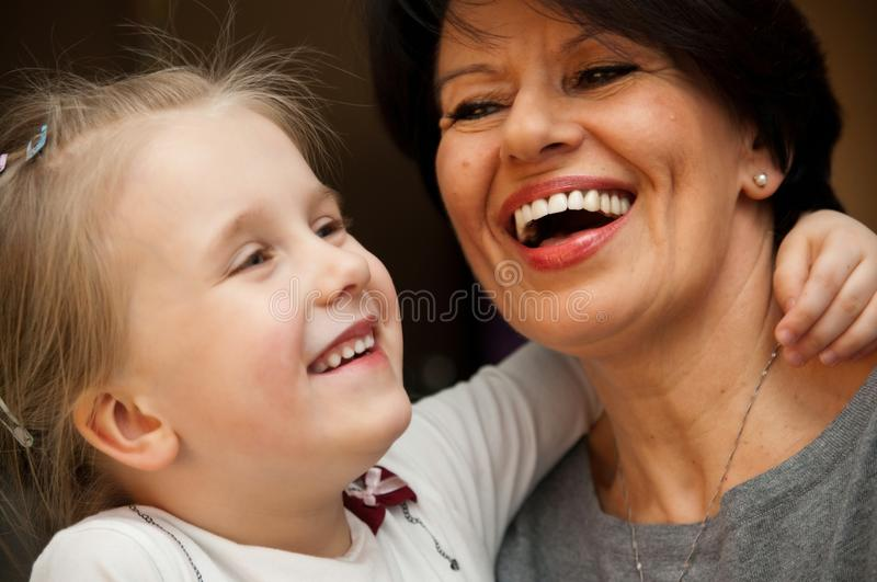 Girl and grandmother smiling stock photography