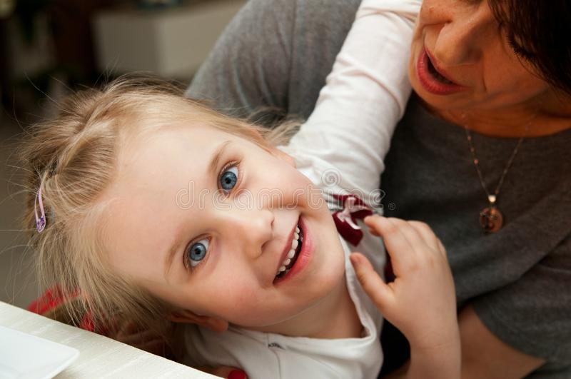 Girl and grandmother smiling stock photo