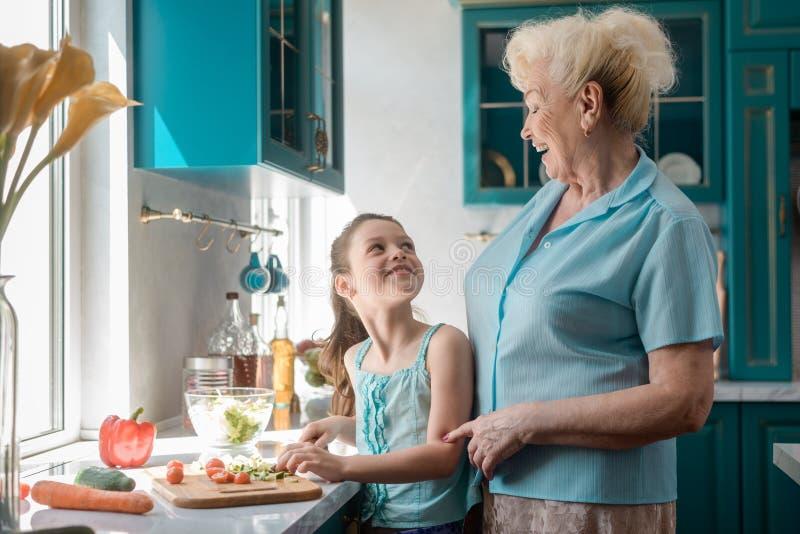 Girl and granny having fun stock photo